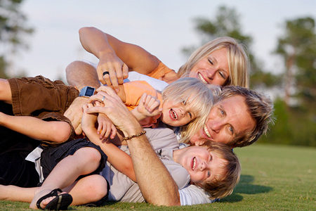 Family-playing-in-grass1