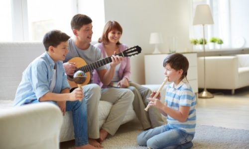 Family-playing-musical-instruments_1098-771